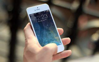 Person unlocking iphone.